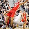 Don Knight | The Herald Bulletin<br /> Frankton's Kayden Key grabs an offensive rebound while drawing a foul from Covington's Ty Bever in the regional final at Lapel on Saturday.