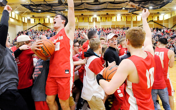 Don Knight | The Herald Bulletin<br /> Frankton's student section runs onto the floor after Brayton Cain accepted the regional hardware and game ball as the Eagles defeated Covington to win the regional at Lapel on Saturday.