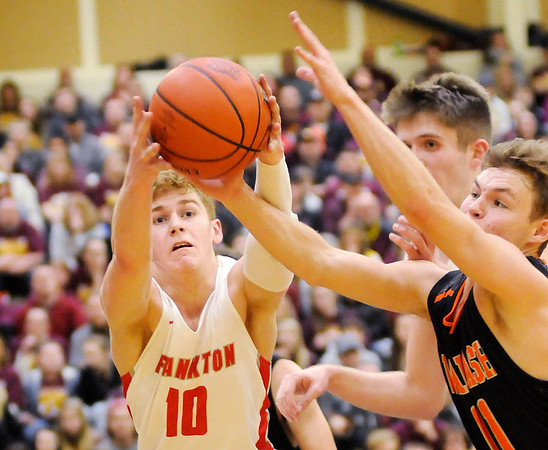Don Knight   The Herald Bulletin<br /> Frankton's Brayton Cain grabs a loose ball as the Eagles faced the Wabash Apaches in the first round of the regional at Lapel on Saturday.