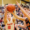 Don Knight | The Herald Bulletin<br /> Frankton's Brayton Cain grabs a loose ball as the Eagles faced the Wabash Apaches in the first round of the regional at Lapel on Saturday.