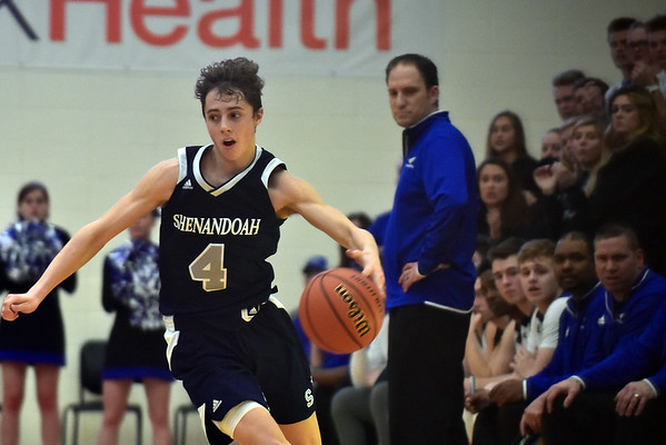 Shenandoah sophomore guard Jakeb Kinsey gets a steal with Heritage Christian Coach Corey Jackson looking on in the third quarter. Shenandoah defeats Heritage Christian 62-55 on Saturday to advance to the final of the 2A Regional 11 at Greenfield. Richard Sitler photo