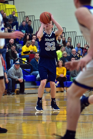 Shenandoah senior Evan Coers lines up a shot during the third quarter against Heritage Christian. Shenandoah defeats Heritage Christian 62-55 on Saturday to advance to the final of the 2A Regional 11 at Greenfield. Richard Sitler photo