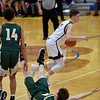 The official calls a blocking foul on Northeastern defender Benjamin Deitsch who is on the floor after colliding with Shenandoah guard Andrw Bennett during the fourth quarter in the regional final at Greenfield on Saturday. Shenandoah defeated Northeastern 42-37 to win the regional championship.