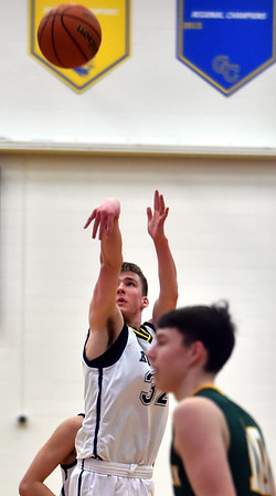 Evan Coers connects on a three-point shot for Shenandoah during the second quarter in the regional final against Northeastern at Greenfield on Saturday.