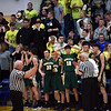 An official explains a foul call to Northeastern Coach Brent Ross as the fans and players look pensive seeing their chances slip away during the fourth quarter of the regional final at Greenfield on Saturday. Shenandoah defeated Northeastern 42-37 to win the regional championship.