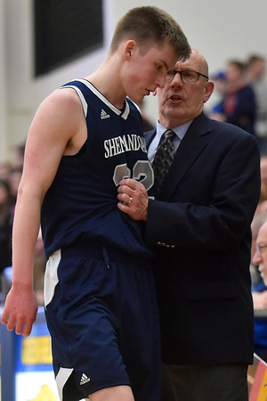 Shenandoah Coach David McCollough interacts with his son Kaden McCollough as the sophomore guard comes to the bench during a break in action. Shenandoah defeats Heritage Christian 62-55 on Saturday to advance to the final of the 2A Regional 11 at Greenfield. Richard Sitler photo
