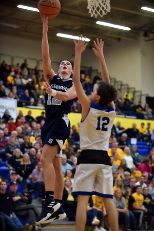 Shenandoah sophomore Andrew Bennett attempts a layup over Heritage Christian defender Jack Arterburn. Shenandoah defeats Heritage Christian 62-55 on Saturday to advance to the final of the 2A Regional 11 at Greenfield. Richard Sitler photo