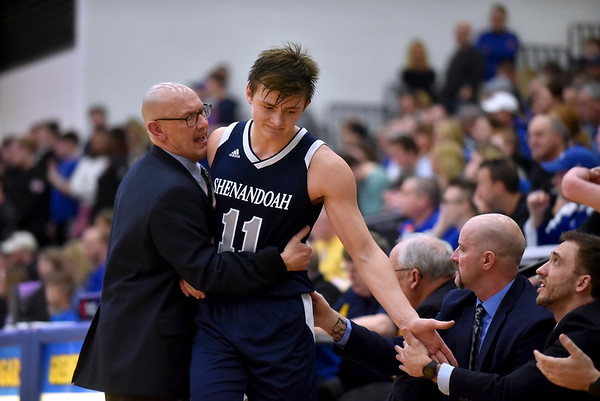 Shenandoah junior Peyton Starks receives encouragement from Coach David McCollough and the Raider coaching staff as Starks comes out of the game. Shenandoah defeats Heritage Christian 62-55 on Saturday to advance to the final of the 2A Regional 11 at Greenfield. Richard Sitler photo