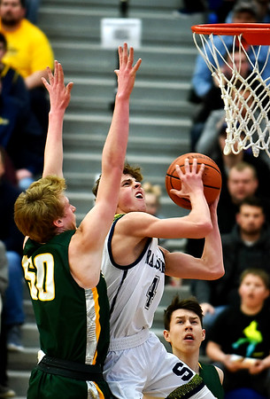 Shenandoah sophomore Jakeb Kinsey gets past Northeastern defender Caylor Fisher for a layup in the first quarter Saturday in the championship game of the 2A regional 11 at Greenfield. Photo by Richard Sitler