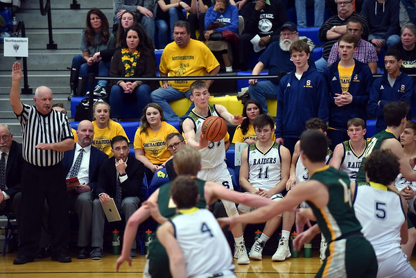 Evan Coers inbounds the ball during the fourth quarter in the regional final at Greenfield on Saturday. Shenandoah defeated Northeastern 42-37 to win the regional championship.