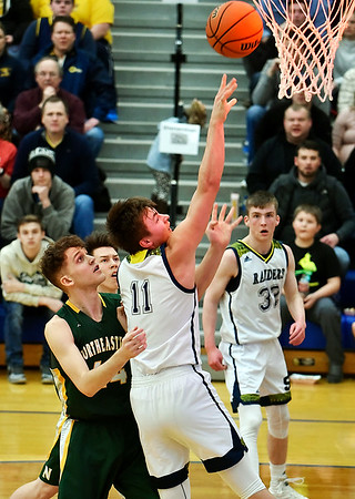 Shenandoah forward Peyton Starks puts up a shot at the buzzer at the end of the first quarter against Northeastern in the regional final at Greenfield on Saturday. Photo by Richard Sitler