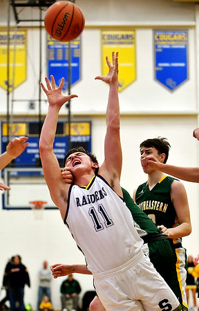 Shenandoah's Peyton Starks is fouled while trying to grab a rebound during the second quarter against Northeastern in the regional final at Greenfield on Saturday. Photo by Richard Sitler