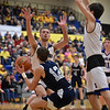 Shenandoah's Andrew Bennett draws a Heritage Christian double team. as he looks for his shot under the basket in the fourth quarter. Shenandoah defeats Heritage Christian 62-55 on Saturday to advance to the final of the 2A Regional 11 at Greenfield. Richard Sitler photo