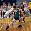 Shenandoah junior Jackson Campbell and Northeastern's Carter Lumpkin (2) and Benjamin Deitsch (10) compete for a loose ball during the fourth quarter in the regional final at Greenfield on Saturday. Shenandoah defeated Northeastern 42-37 to win the regional championship.