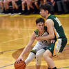 Shenandoah guard Andrew Bennett collides with Northeastern defender Benjamin Deitsch during the fourth quarter in the regional final at Greenfield on Saturday. Shenandoah defeated Northeastern 42-37 to win the regional championship.