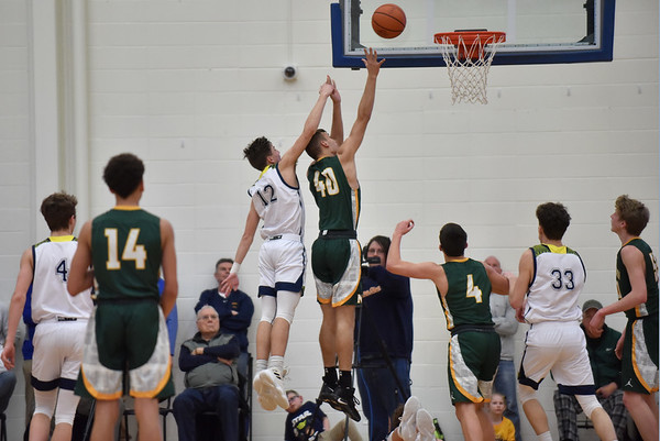 Shenandoah's Andrew Bennett and Northeastern's Michael White compete for a rebound during the third quarter of the regional final at Greenfield on Saturday.