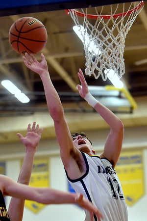 Shenandoah sophomore Andrew Bennett puts up a shot during the second quarter of the regional final at Greenfield on Saturday.