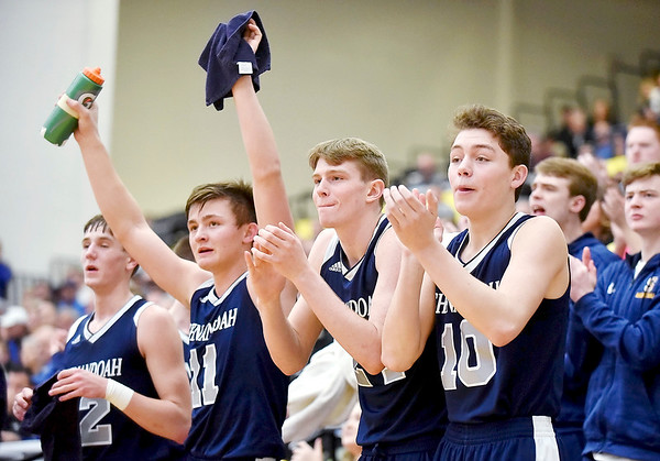 Richard Sitler   For The Herald Bulletin<br /> Players on the Shenandoah bench react as their teammate scores during the third quarter. Shenandoah defeats Heritage Christian 62-55 on Saturday to advance to the final of the 2A Regional 11 at Greenfield.