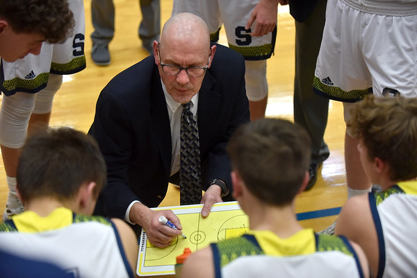 Coach David McCollough draws up a play for Shenandoah during a fourth quarter timeout during the regional final against the Northeastern Knights on Saturday at Greenfield.