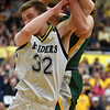 Shenandoah senior Evan Coers battles Northeastern's Cole Mikesell for a rebound during the regional final at Greenfield on Saturday. Shenandoah defeated Northeastern 42-37 to win the regional championship.