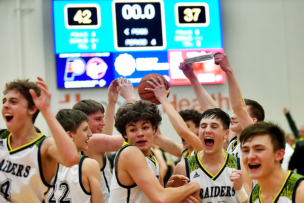 The Shenandoah Raiders celebrate as they win the IHSAA 2A Regional 11 at Greenfield on Saturday. Photo by Richard Sitler