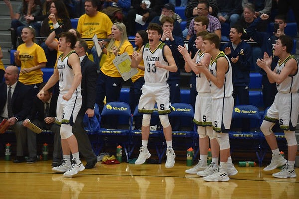 The Shenandoah bench reacts as it becomes apparent that the Raiders have iced the win. Shenandoah defeated Northeastern 42-37 to win the regional championship.
