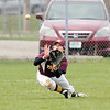 Don Knight | The Herald Bulletin<br /> Alexandria's Miller Abernathy makes a diving catch in the outfield as Anderson hosted Alexandria in the first round of the Nick Muller Tournament on Tuesday.