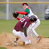 Don Knight | The Herald Bulletin<br /> Alexandria's Rylan Metz runs into Anderson's Clay Stanley as he looks to turn a double play in the first round of the Nick Muller Tournament on Tuesday. Metz was called for interference.