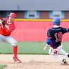 Don Knight | The Herald Bulletin<br /> Elwood's Hunter Scholl beats the throw to Frankton's JJ Hatzell as he steals second on Wednesday.