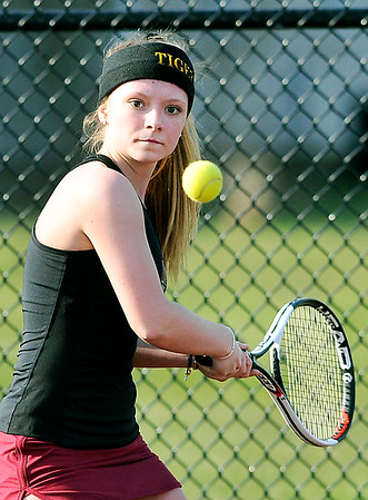 John P. Cleary | The Herald Bulletin  <br /> Alexandria's no. 3 singles, McKenzie Adams, returns a backhand shot during her match.
