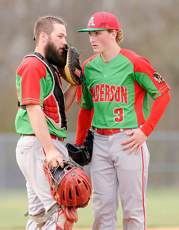 Don Knight   The Herald Bulletin<br /> Anderson catcher Cameron McGlothlin goes out to the mound to talk to pitcher Tristen Brooks as the Indians faced the Lapel Bulldogs on Thursday in the semifinal round of the Nick Muller Memorial Baseball Tournament.
