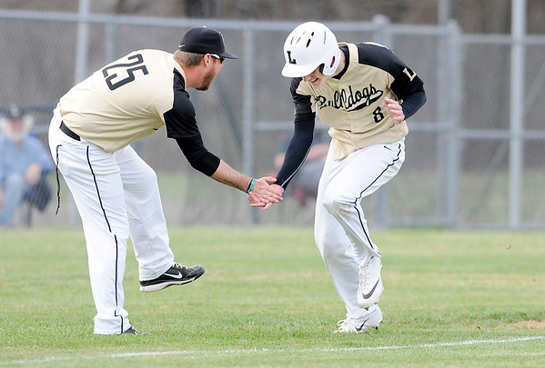 Don Knight | The Herald Bulletin<br /> Lapel's Justin Engle low fives coach Matt Campbell as he rounds the bases on a three run homerun in the semifinal round of the Nick Muller Memorial Baseball Tournament.