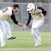 Don Knight   The Herald Bulletin<br /> Lapel's Justin Engle low fives coach Matt Campbell as he rounds the bases on a three run homerun in the semifinal round of the Nick Muller Memorial Baseball Tournament.