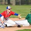 Don Knight | The Herald Bulletin<br /> Pendleton Heights' Bryce Riggs steals second beating the throw to Elwood's Jack Bennett on Wednesday.