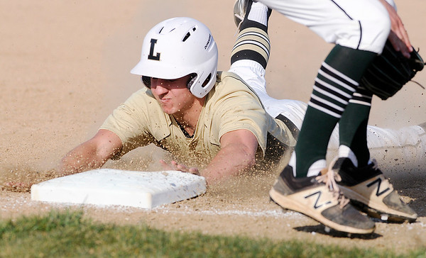 Don Knight | The Herald Bulletin<br /> Lapel's Mason Gilley steals third as the Bulldogs hosted the Pendleton Heights Arabians in the semi-final round of the Nick Muller Tournament on Thursday.