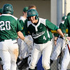 Don Knight | The Herald Bulletin<br /> Pendleton Heights Rene Casas (4) celebrates with Kamden Earley (20) after Earley crossed homeplate during a 10-run fifth inning for the Arabians in the semi-final round of the Nick Muller Tournament on Thursday.