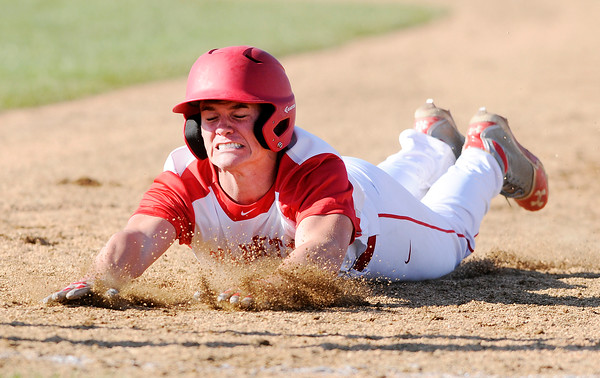 Don Knight | The Herald Bulletin<br /> Frankton's Mitchell Wiley dives back to first base as the Eagles faced APA in the first round of the Muller tournament at Frankton on Wednesday.