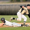 Don Knight | The Herald Bulletin<br /> Lapel's Mason Gilley steals second base as the Bulldogs hosted Madison-Grant on Thursday.
