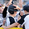 Don Knight | The Herald Bulletin<br /> Lapel's John Sherwood is greeted by his teammates as he returns to the dugout after hitting a RBI single as the Bulldogs beat the Madison-Grant Argylls to advance to the Muller final on Thursday.