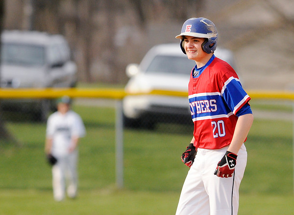 Don Knight | The Herald Bulletin<br /> Elwood's Cameron Smith smiles as he stands on second base after batting in a run to give the Pathers a 1-0  lead over Pendleton Heights in the Nick Muller Memorial Tournament on Friday at Memorial Field.