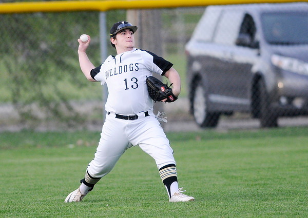 Don Knight | The Herald Bulletin<br /> Lapel's David Rebenack throws to the infield after catching a fly ball in left field as the Bulldogs faced the Pendleton Heights Arabians in the Nick Muller Memorial Tournament championship on Saturday.
