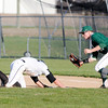 Don Knight | The Herald Bulletin<br /> Lapel's Jaxon Shirley attempts to dive under the tag of Pendleton Heights first baseman Casey Branham after getting caught between first and second   during the Nick Muller Memorial Baseball Tournament at Lapel on Thursday.