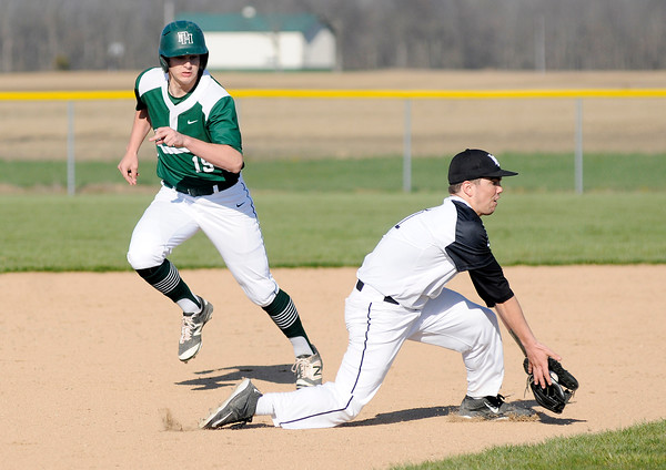 Don Knight | The Herald Bulletin<br /> Pendleton Heights' Sam Issacs runs past Lapel's John Sherwood as he fields a ground ball during the Nick Muller Memorial Baseball Tournament at Lapel on Thursday.