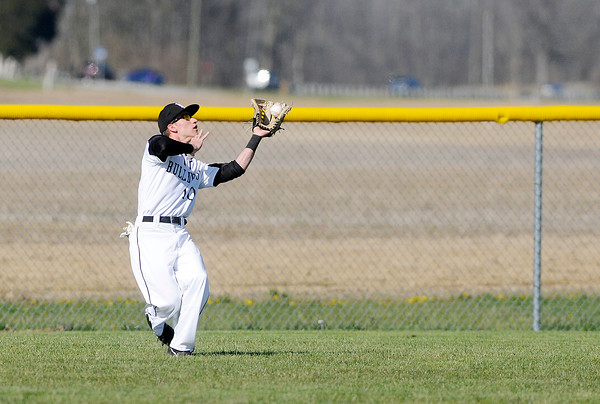 Don Knight | The Herald Bulletin<br /> Lapel's Dylan Dowden catches a fly ball in left field as the Bulldogs hosted the Pendleton Heights Arabians during the Nick Muller Memorial Baseball Tournament at Lapel on Thursday.