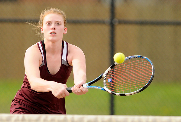 Don Knight   The Herald Bulletin<br /> Alexandria's Mary Sayre returns a volley at the net as Sayre and Megan Miller faced Madison-Grant's Abbey Gunning and Lexi Crouse in the No. 1 singles match in the championship of the Madison County Tennis Tournament on Friday.