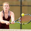 Don Knight | The Herald Bulletin<br /> Alexandria's Mary Sayre returns a volley at the net as Sayre and Megan Miller faced Madison-Grant's Abbey Gunning and Lexi Crouse in the No. 1 singles match in the championship of the Madison County Tennis Tournament on Friday.
