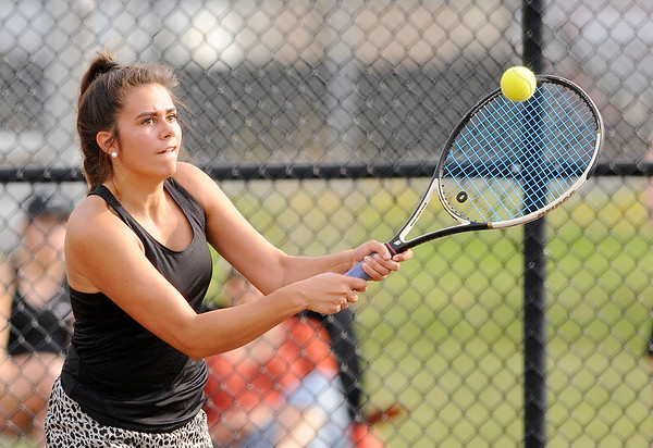 Don Knight | The Herald Bulletin<br /> Madison-Grant's Lauren McGuire returns a volley to Alexandria's Lindsie Chaplin in the No. 2 singles match as the Tigers hosted the Argylls for the championship of the Madison County Tennis Tournament on Friday.