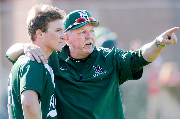 Don Knight   The Herald Bulletin<br /> Pendleton Heights assistant coach Jeff Freeman coaches Mitchell Fowler as the Arabians played the Anderson Indians at Memorial Field during the Nick Muller Memorial Baseball Tournament on Friday.