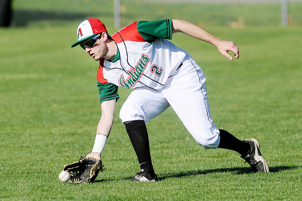 Don Knight | The Herald Bulletin<br /> Anderson's Jake Reed fields a hit in right field as the Indians faced Pendleton Heights at Memorial Field during the Nick Muller Memorial Baseball Tournament on Friday.