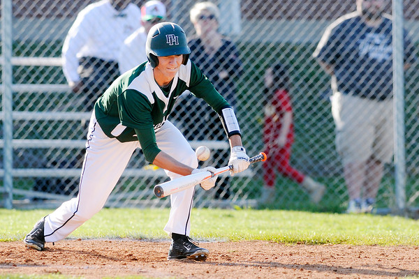 Don Knight   The Herald Bulletin<br /> Pendleton Heights' Eston Stull lays down a sacrifice bunt to advance Noah Gaar to third base as the Arabians faced the Anderson Indians at Memorial Field during the Nick Muller Memorial Baseball Tournament on Friday.